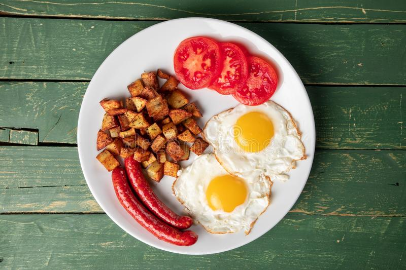 Baked sausage with eggs and potato stock images
