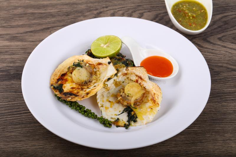 Baked scallops with spinach stock photography
