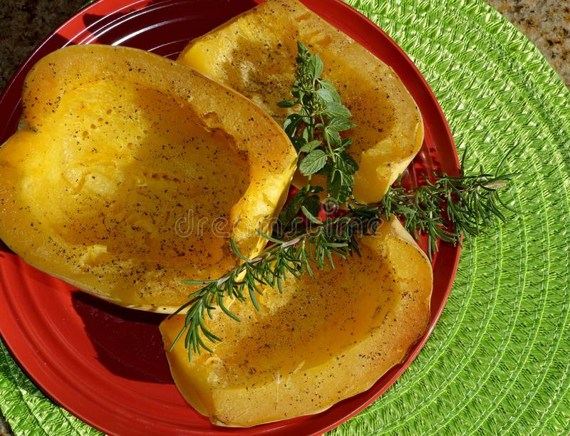 Baked Spaghetti Squash with garnish. Spaghetti squash or vegetable spaghetti, is a group of cultivars of Cucurbita pepo. Found in a variety of shapes, sizes, and stock photo