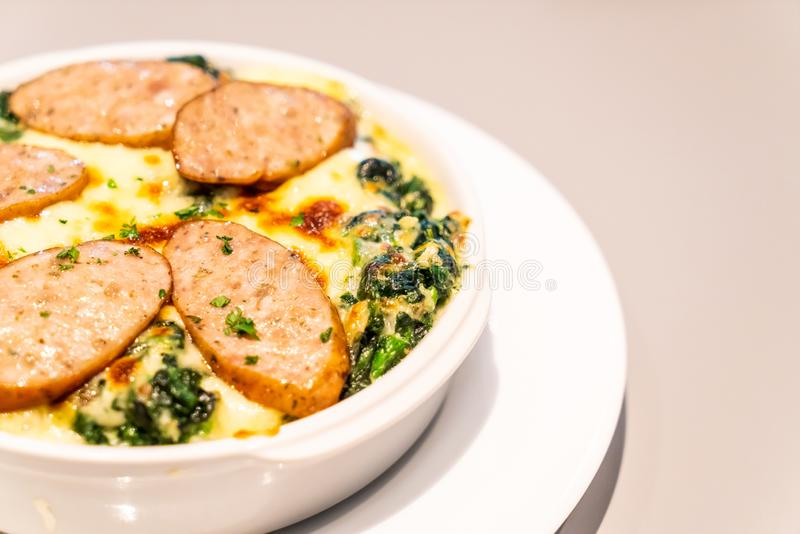 baked spinach with cheese and sausage stock images