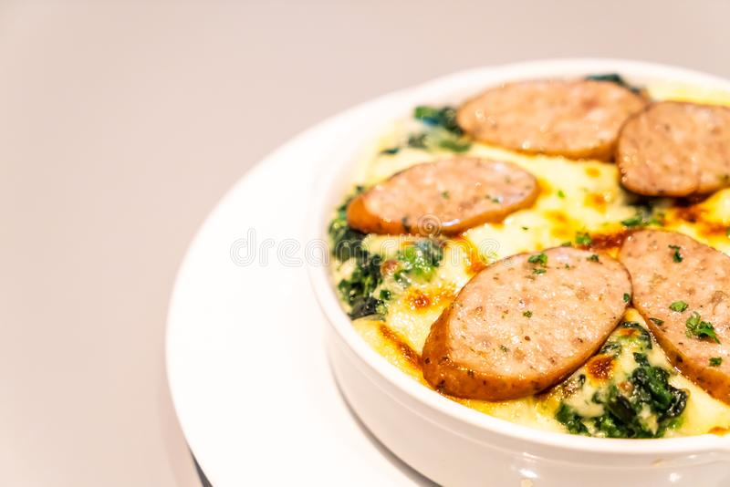 baked spinach with cheese and sausage stock photos