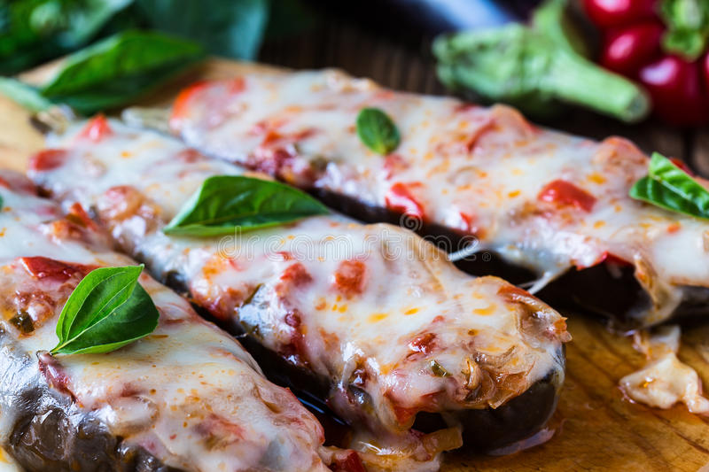 Baked stuffed eggplant stock images