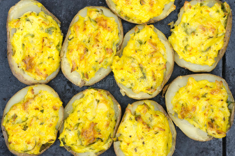 Baked stuffed potatoes royalty free stock photography