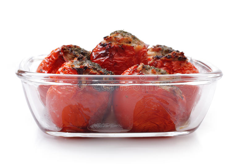 Baked stuffed tomatoes in a glass stock photography