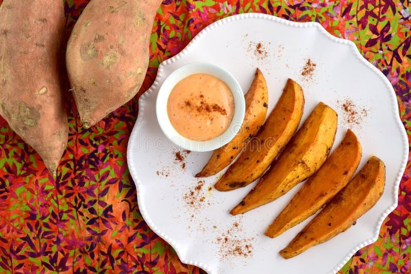 Baked sweet potato wedges royalty free stock images