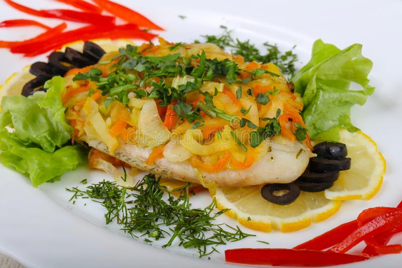 Baked tilapia with vegetables royalty free stock photo