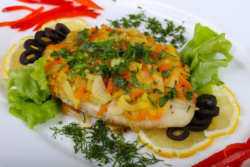 Baked tilapia with vegetables royalty free stock photography