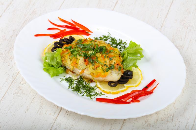 Baked tilapia with vegetables royalty free stock images