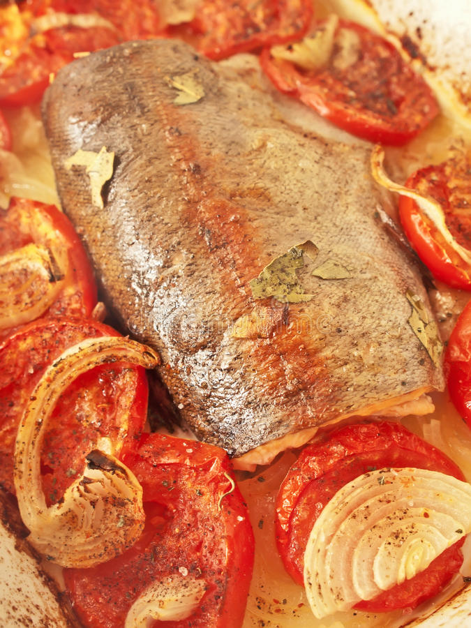 Baked trout with tomatoes and onion royalty free stock images