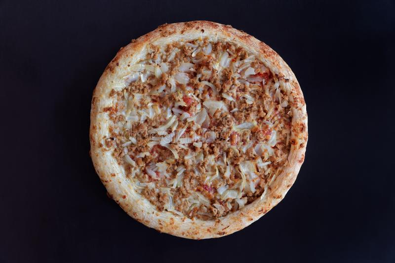 Baked tuna pizza on black background - ready to eat. Directly above photo stock photo
