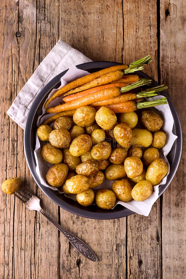 Baked Vegetables Grilled Carrots and Potatoes Vegetables Cooked on the Grill Wooden Background Healthy Diet Food Vertical Top View royalty free stock photos