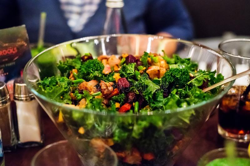 Baked vegetables, walnuts and kale salad royalty free stock photo