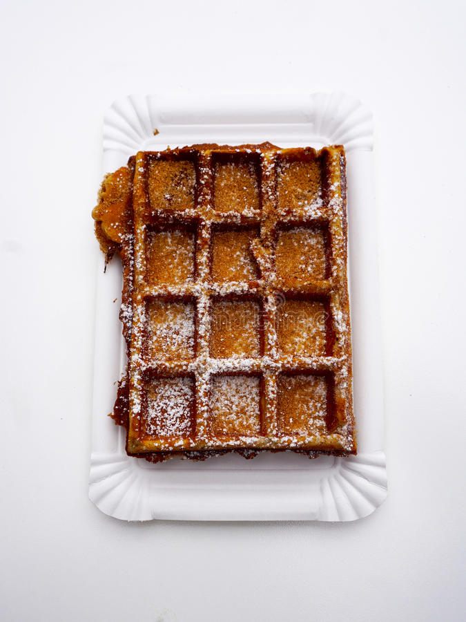 Baked waffle with sugar top view. Baked waffle with sugar and powder top view stock photography