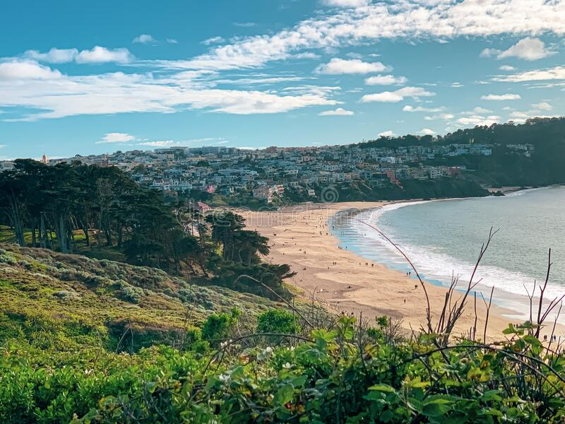Baker beach of San Francisco in spring clear sky day. Baker beach of San Francisco on a  spring day with some white clouds surrounded by eucalyptus forest and royalty free stock images