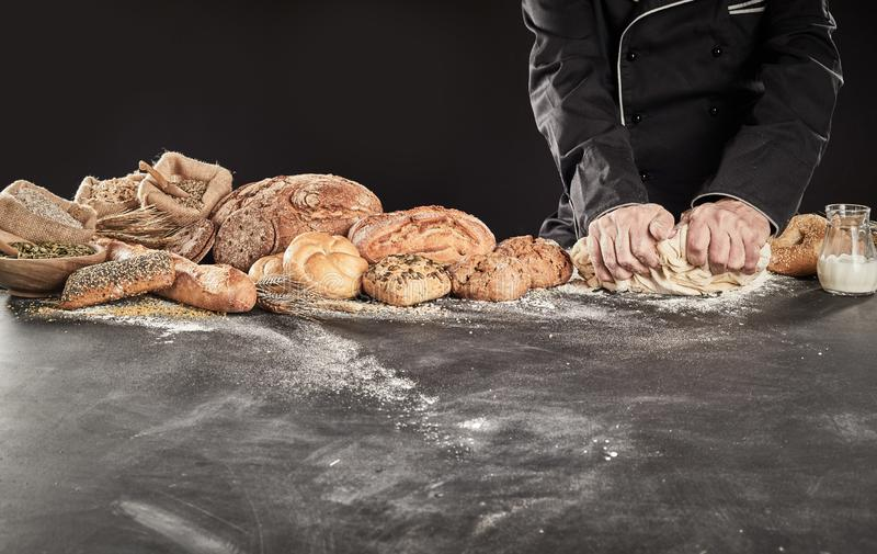 Baker or chef kneading dough for bread stock image