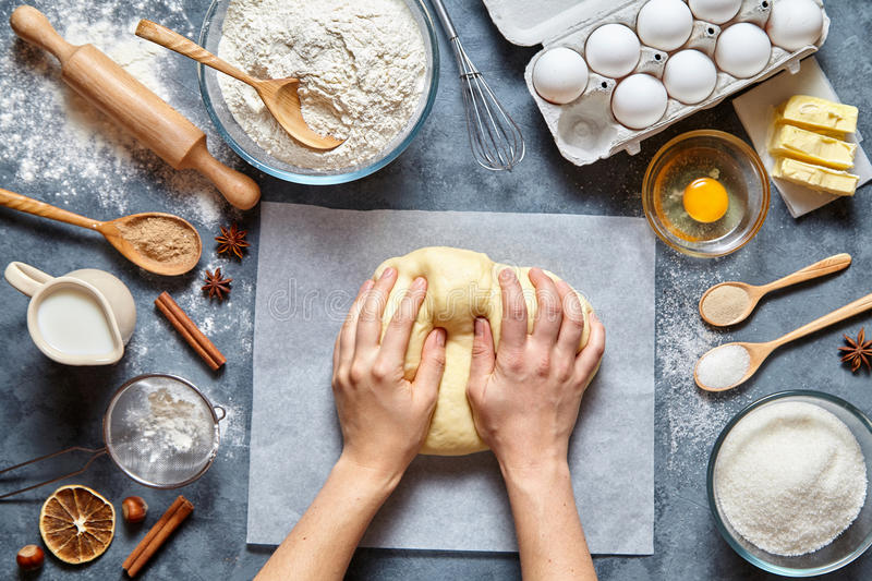 Baker chef preparing homemade dough bread, pizza or pie recipe ingridients, food flat lay stock image