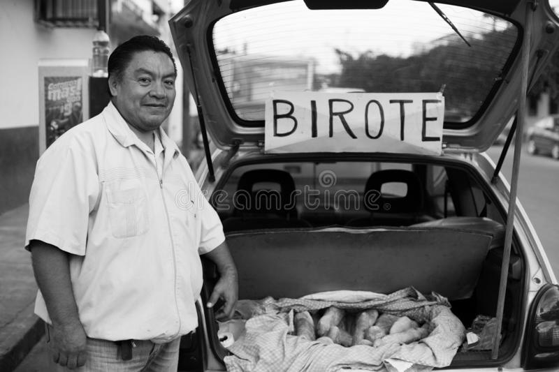 Fresh loaf of birote with baker. Baker and hand made birote bread in Puerto Vallarta, Jalisco, Mexico stock photos