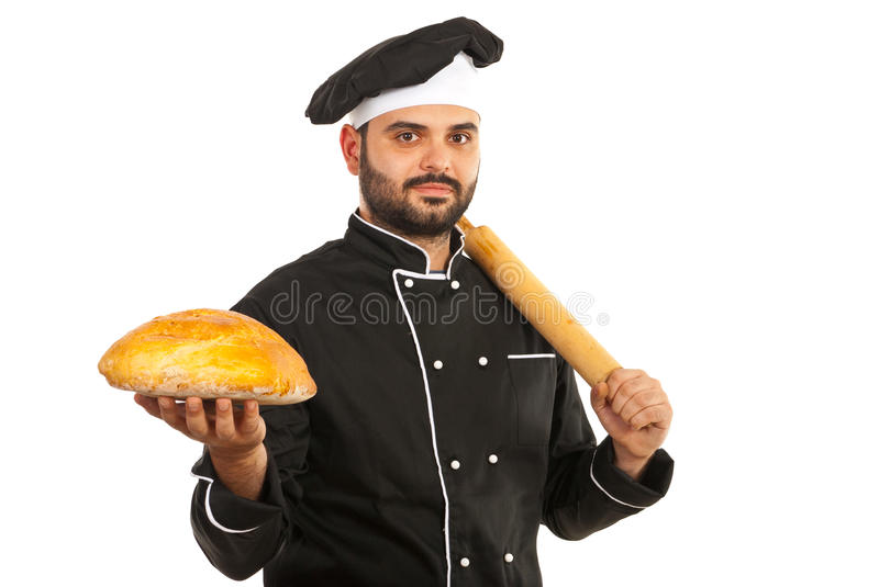 Baker holding bread. Baker man holding bread and rolling pin isolated on white background stock photography