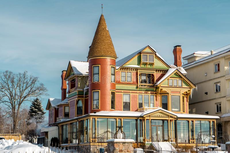 Winter picture of `Baker House` Restaurant with Snowy-covered roof , Lake Geneva WI stock photos