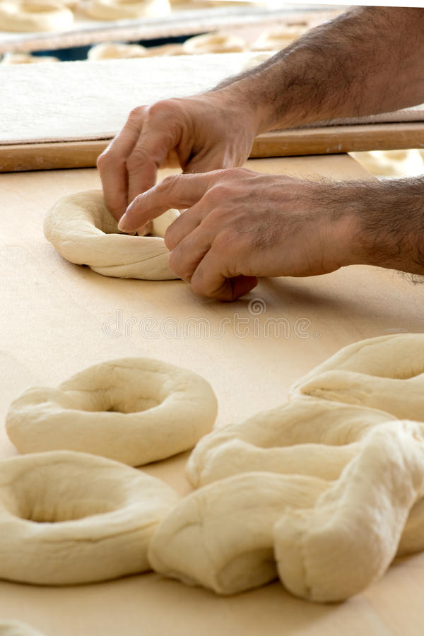 Baker making frisella bread royalty free stock photos