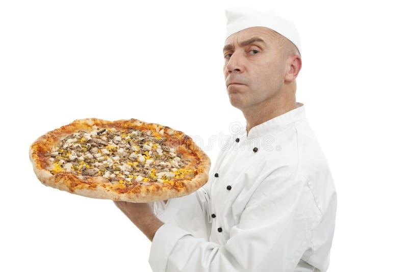 Baker of pizza royalty free stock photos