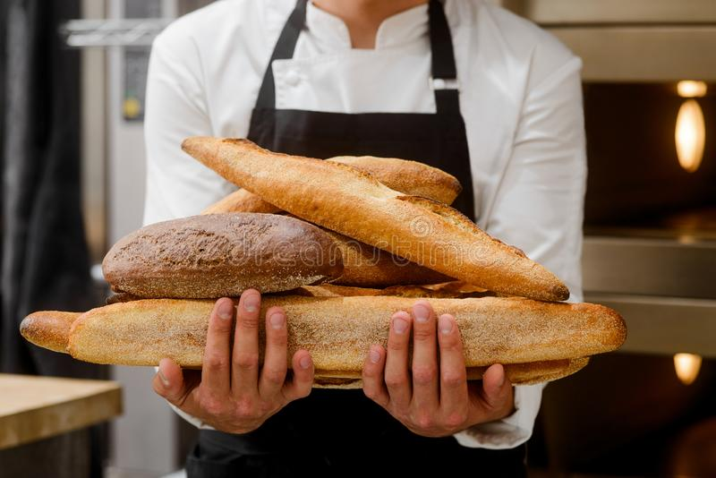 Baker is showing breads royalty free stock photography