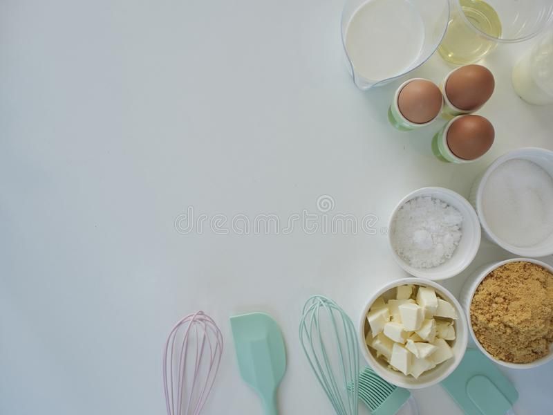 Bakery accessories and ingredients. Ingredients and tools for making cakes, flour, butter, eggs and sugar. Concept for designing bakery menus stock photo