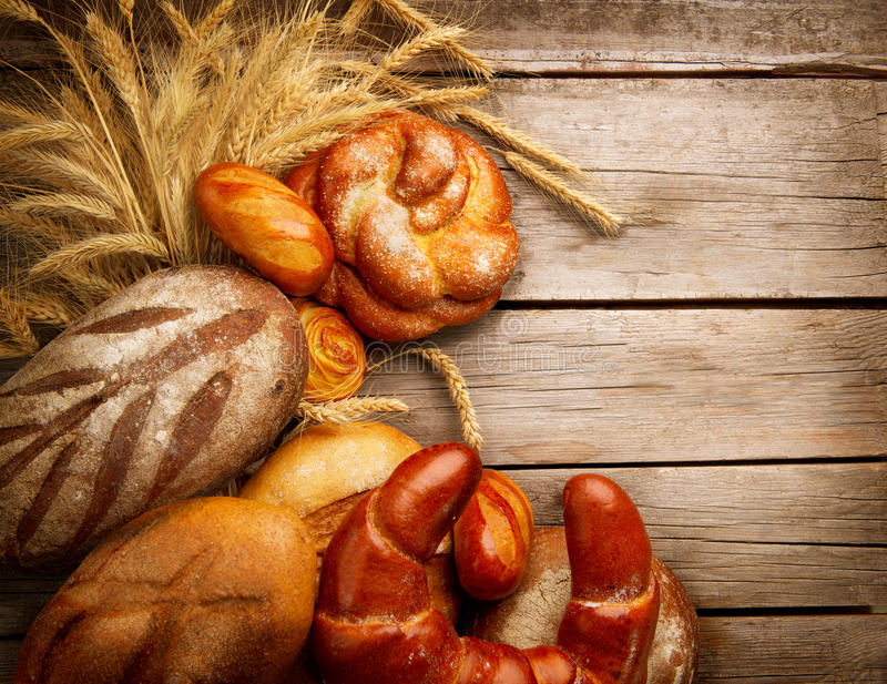 Bakery Bread and Sheaf. Over Wood Background stock photo
