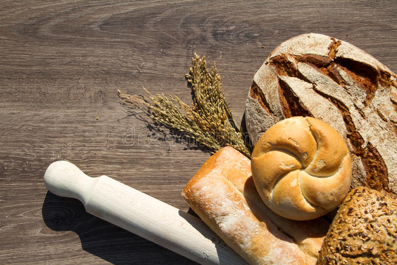 Bakery Bread and Sheaf. Over wood background stock image