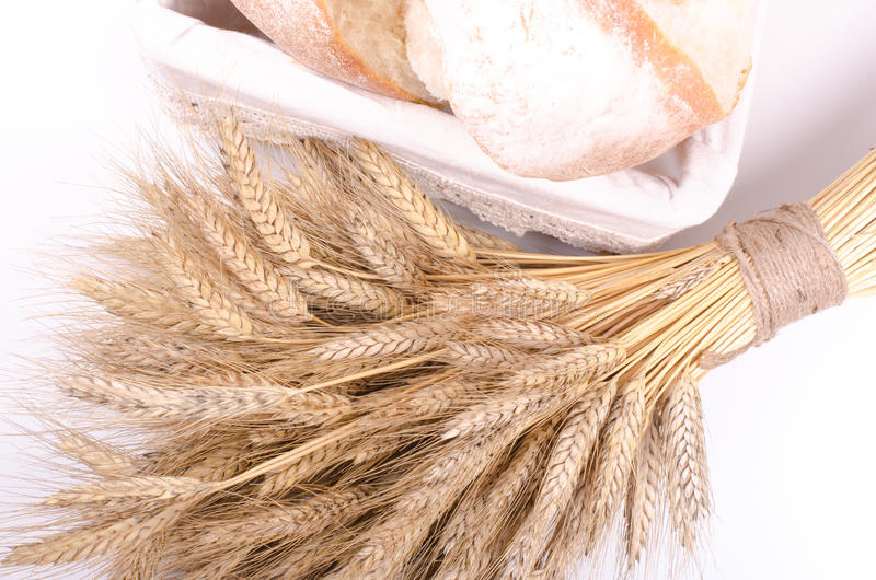 Bakery Bread with sheaf of Wheat Ears on white stock photography