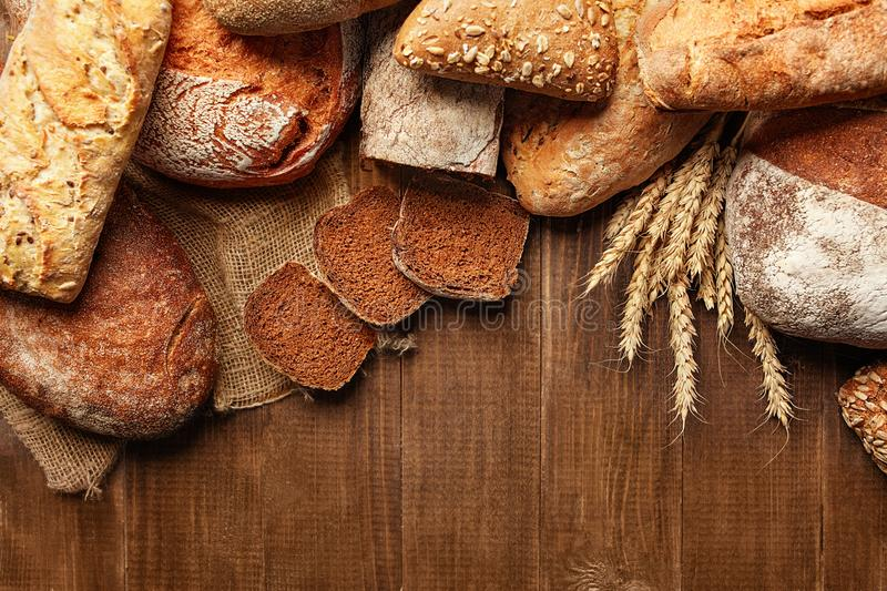 Bakery. Bread On Wood Background royalty free stock images