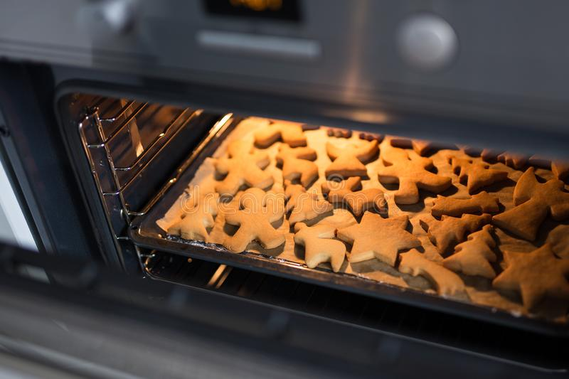 Bakery and cooking - cookies or gingerbreads in oven stock photography
