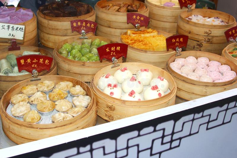 Bakery with delicious sweets in water town Suzhou, China. Bakery with delicious sweets, cookies and mice of marzipan in bamboo baskets in the touristic water stock images