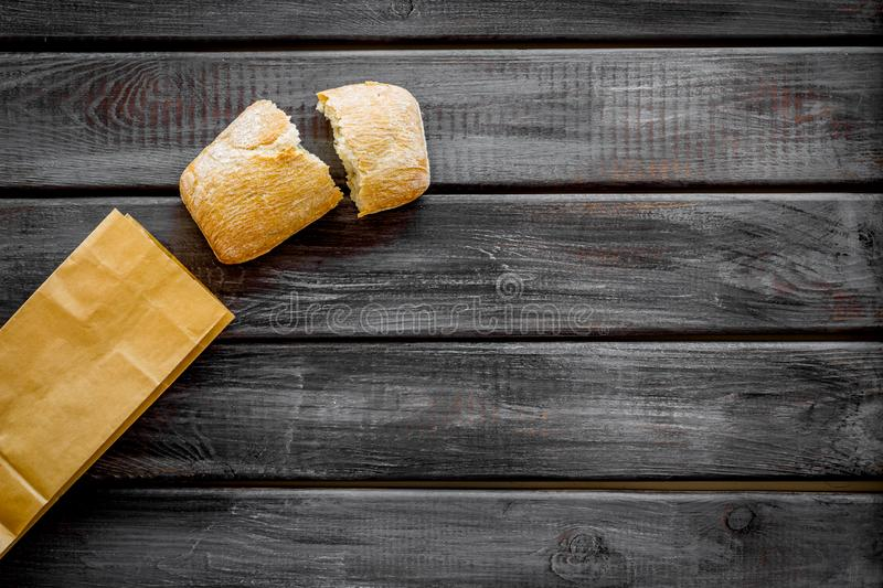 Bakery with fresh french baguette loaf on wooden background top view mockup royalty free stock images