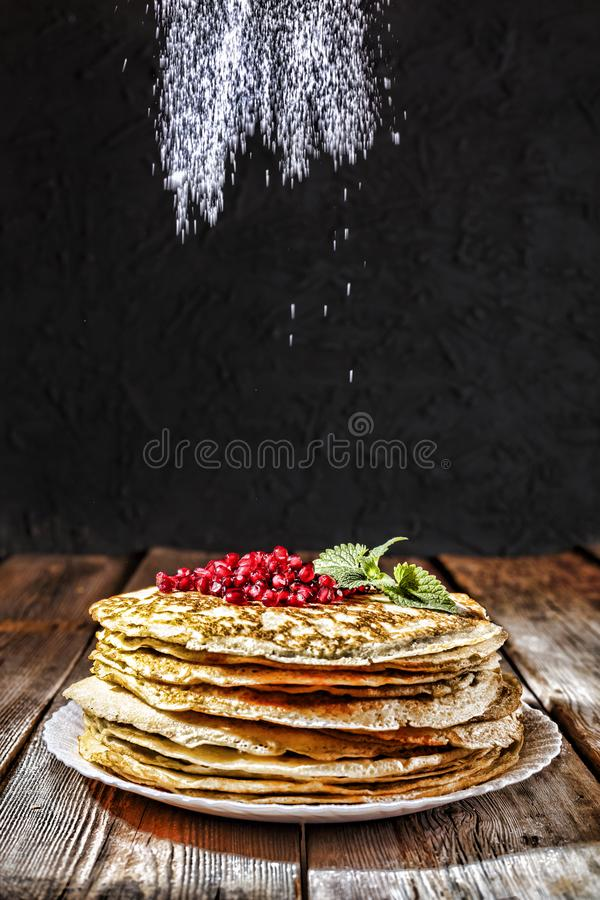 Bakery or homemade cuisine. Homemade pancakes closeup on a wooden table. Rustic style, Russian pancakes, Shrovetide, Mardi Gras. Bakery or homemade cuisine stock photos