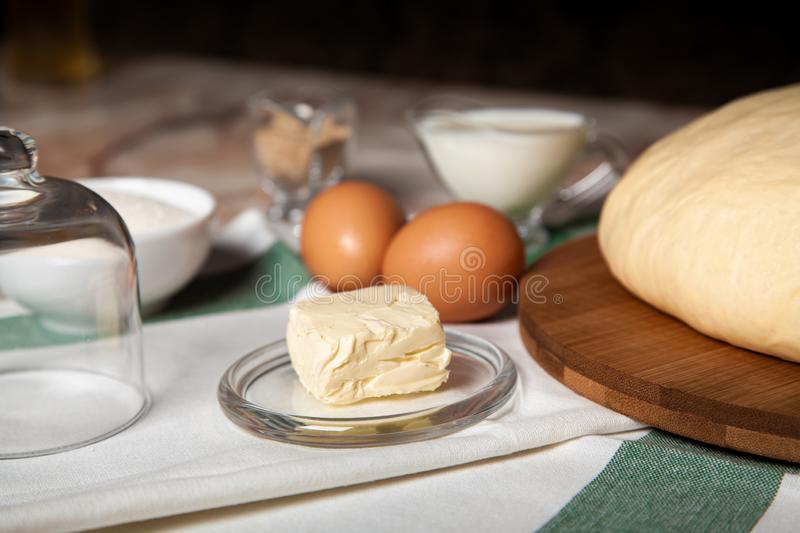 Bakery ingredients. On the table are butter, eggs, milk, yeast, sugar royalty free stock images