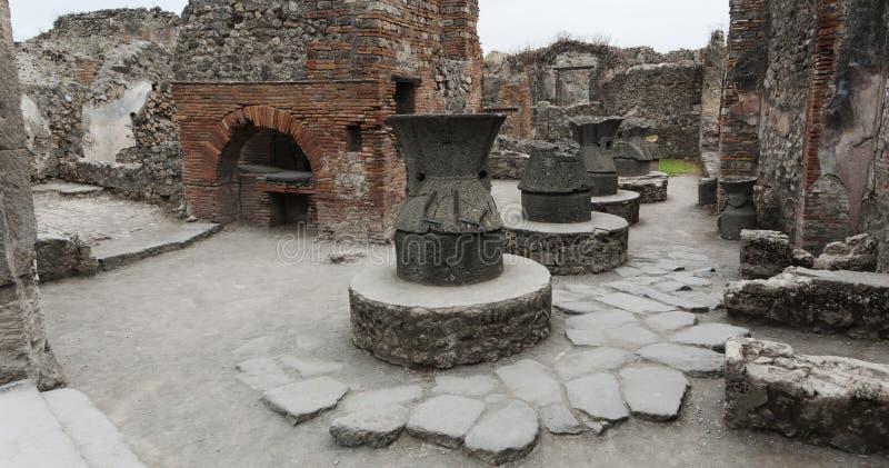 Bakery in Pompeii. Ancient bread ovens in the city of Pompeii. Vesuvius`s eruption. Naples, Campania, Italy royalty free stock photo