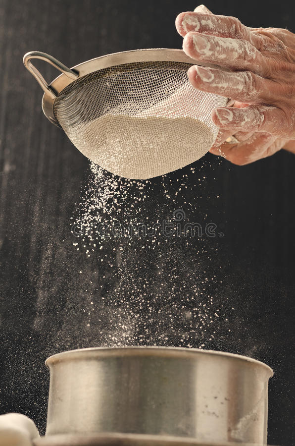 Bakery product. Delicious cooking for you. Cooking process concept. Flour and sieve. Bakery product. Tasty cooking for you. Cooking process. Flour and sieve royalty free stock images