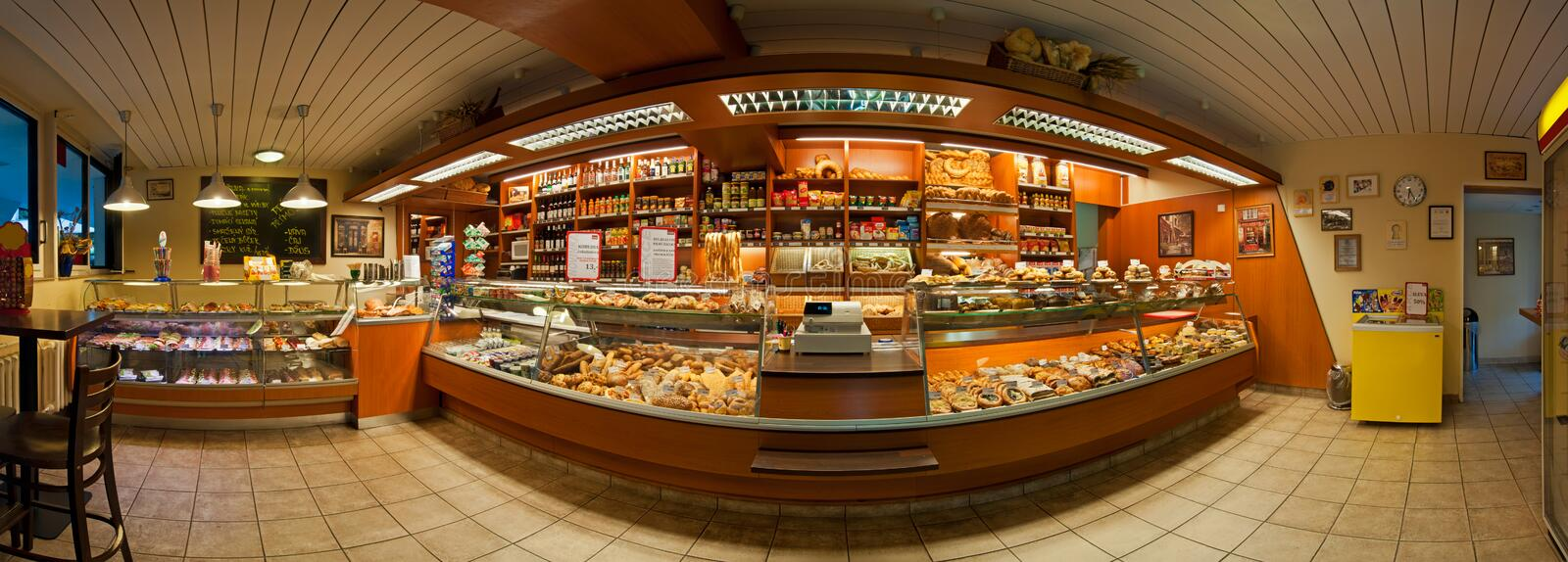 Bakery Shop. PRAGUE, CZECH REPUBLIC - JUNE 29: Panoramic view of a bakery shop interior on June 29, 2012 in Prague, Czech Republic. It shows a small royalty free stock images