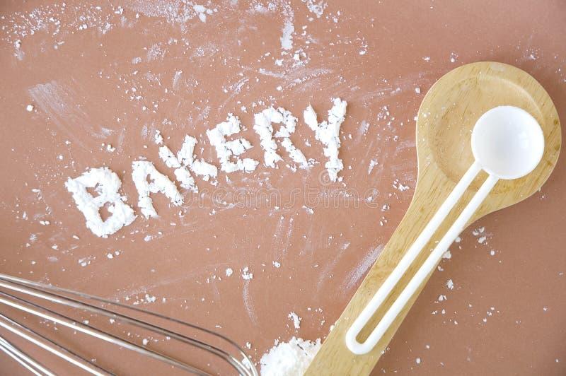 Bakery wording. Make of flour on pink background royalty free stock image