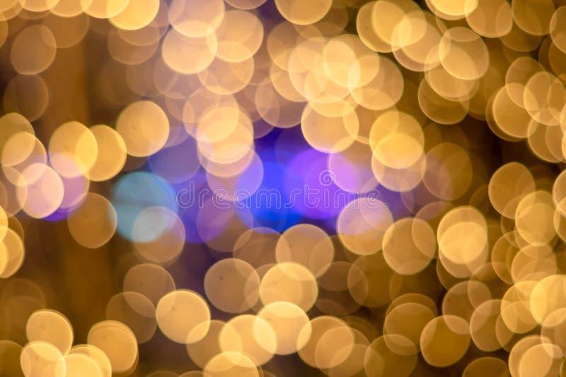 bakgrund ฺChristmasBokeh guld- för ljusa fläckar härlig lampa arkivfoton