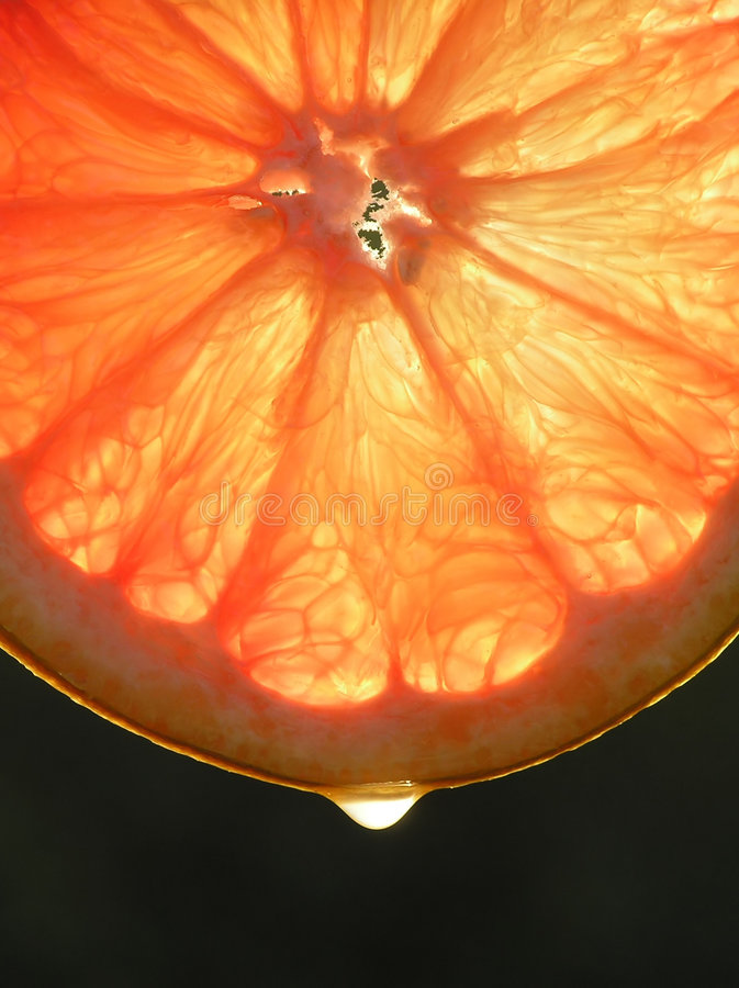 bakgrund är den orange skivan för droppfruktdruvan till använt royaltyfri fotografi