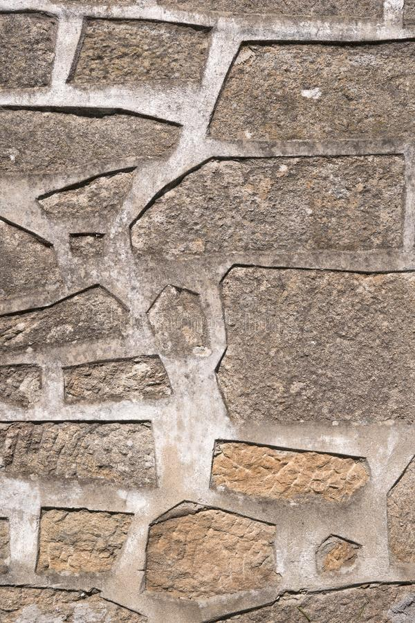 Bakgrund av antikviteten stenar väggen med geometriska modeller arkivfoton