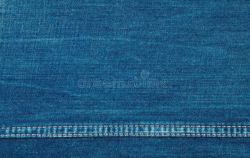 Bakgrund av blå grov denim arkivfoto