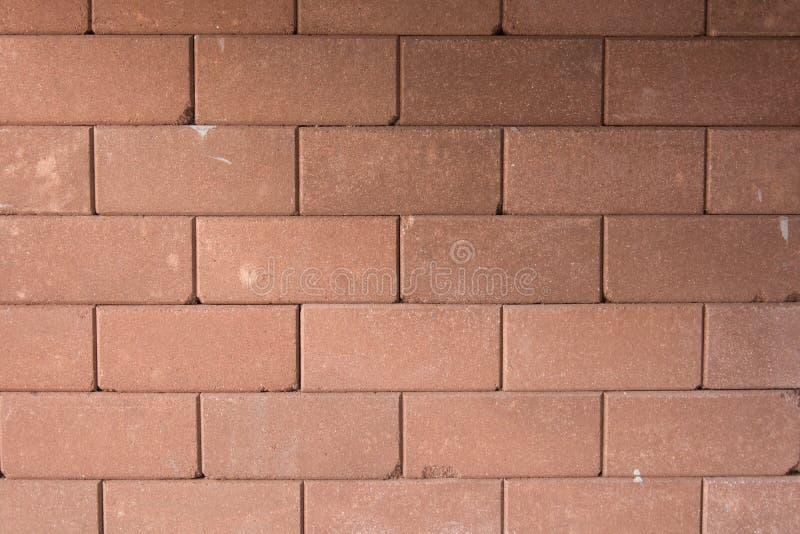 Bakgrund av den bruna tegelstenväggen arkivbild