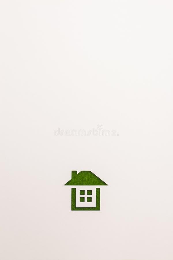 Bakgrund av den färdiga hussymbolen för grön sammet arkivbild