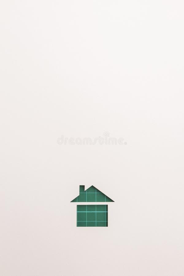 Bakgrund av den gröna bitande grundläggande hussymbolen arkivbild