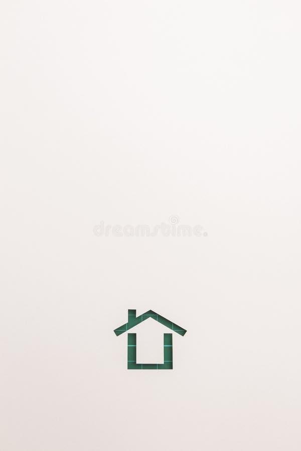 Bakgrund av den gröna bitande minsta hussymbolen royaltyfria bilder