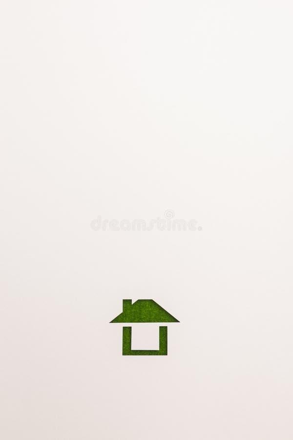 Bakgrund av den lätta hussymbolen för grön sammet arkivbilder