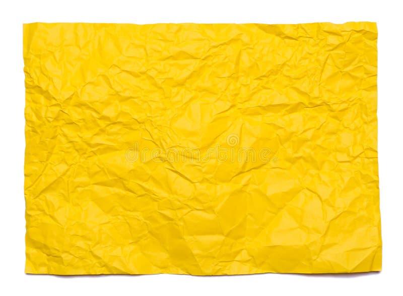 Bakgrund av det guling skrynkliga arket av papper royaltyfria bilder
